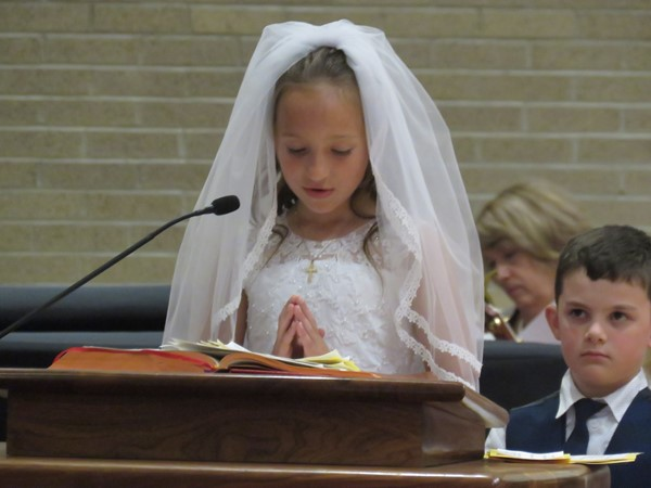 girl reading at communion service