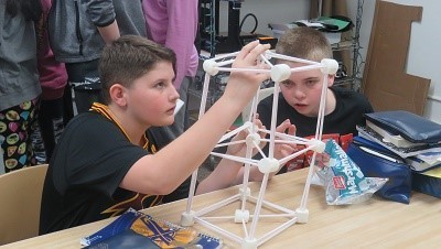 Students creating a structure